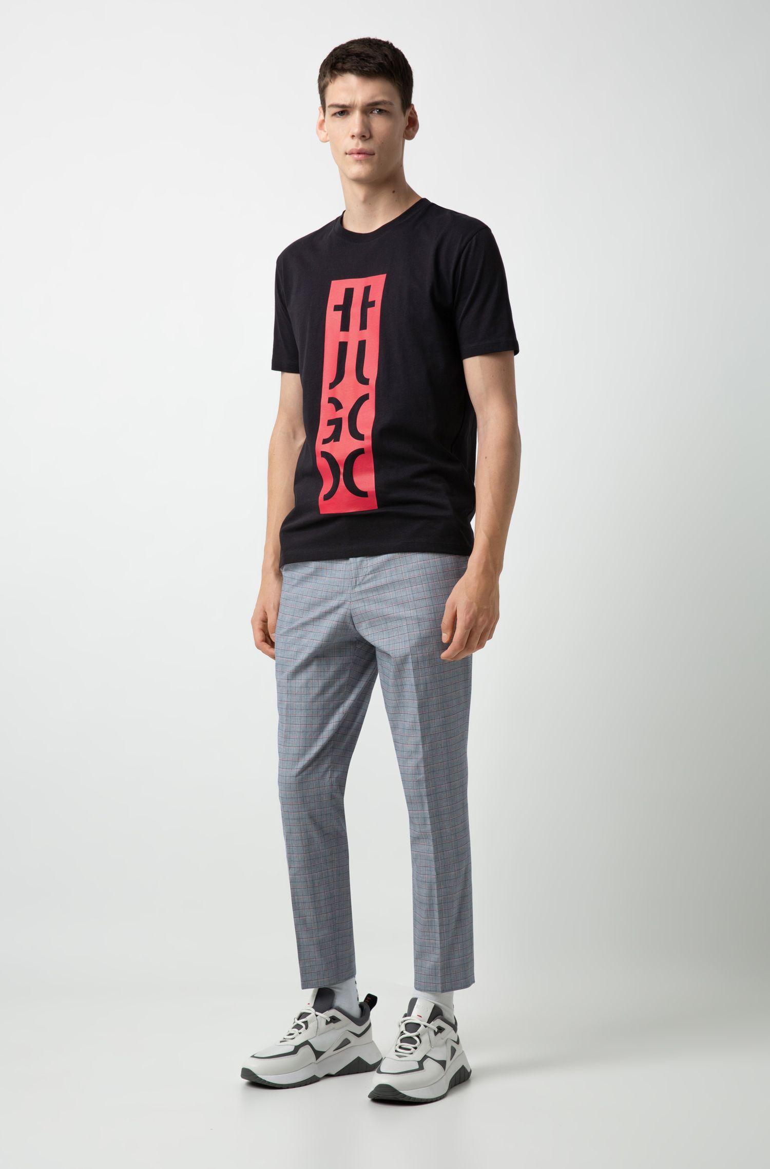 Camiseta relaxed fit con estampado gráfico de logo reinterpretado, Negro