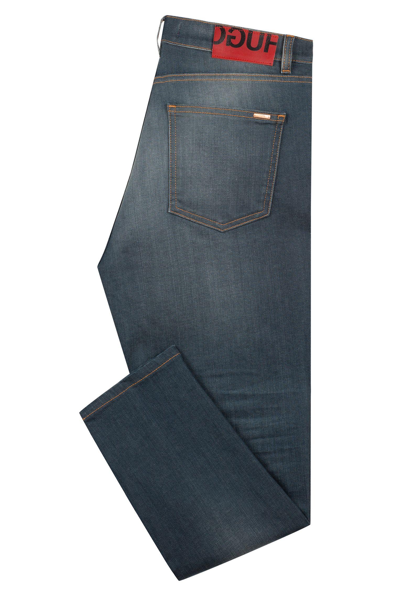 Vaqueros tapered fit en denim elástico con lavado medio, Azul oscuro