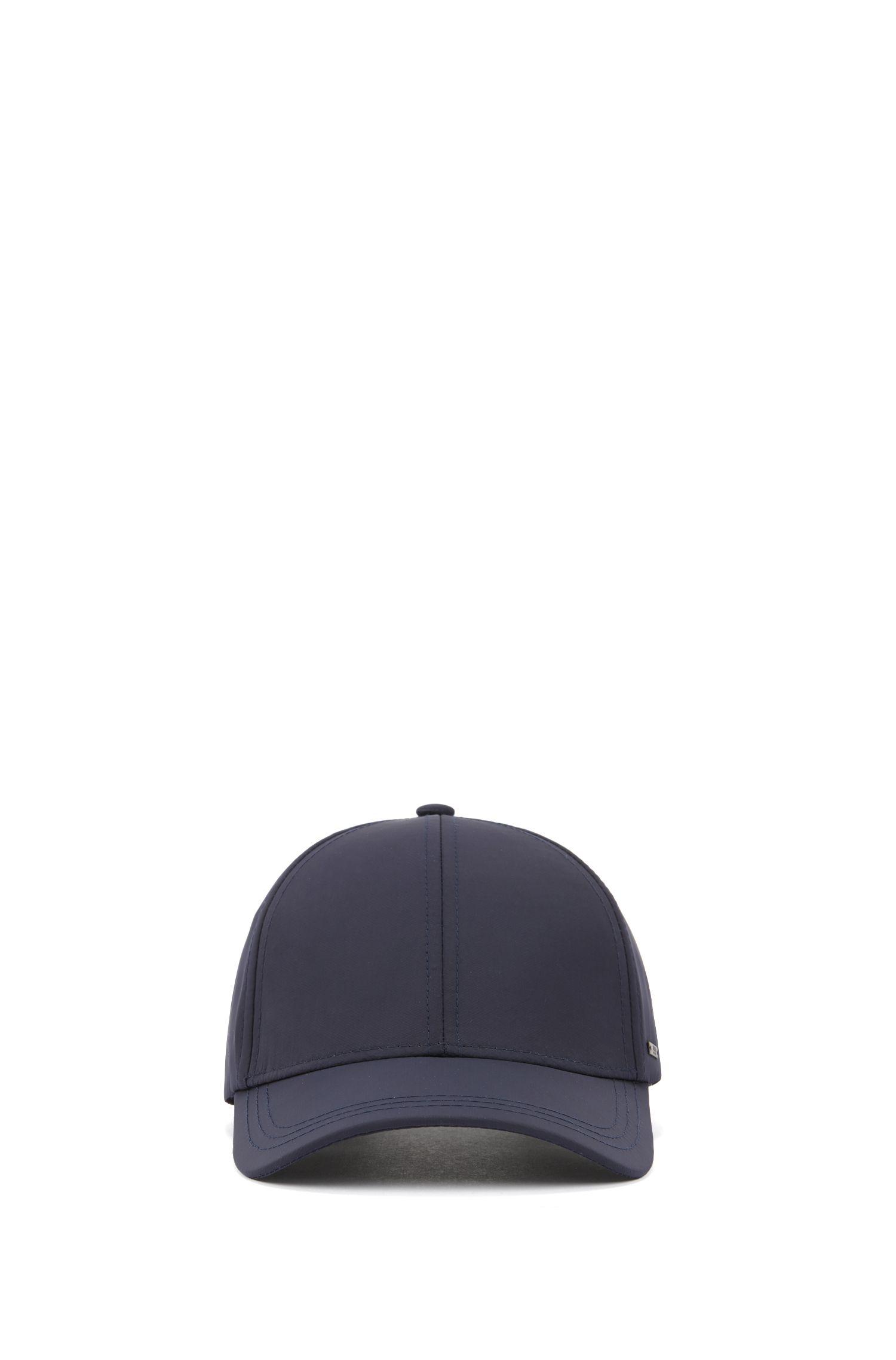 Leichte Cap mit metallener Logo-Applikation, Dunkelblau