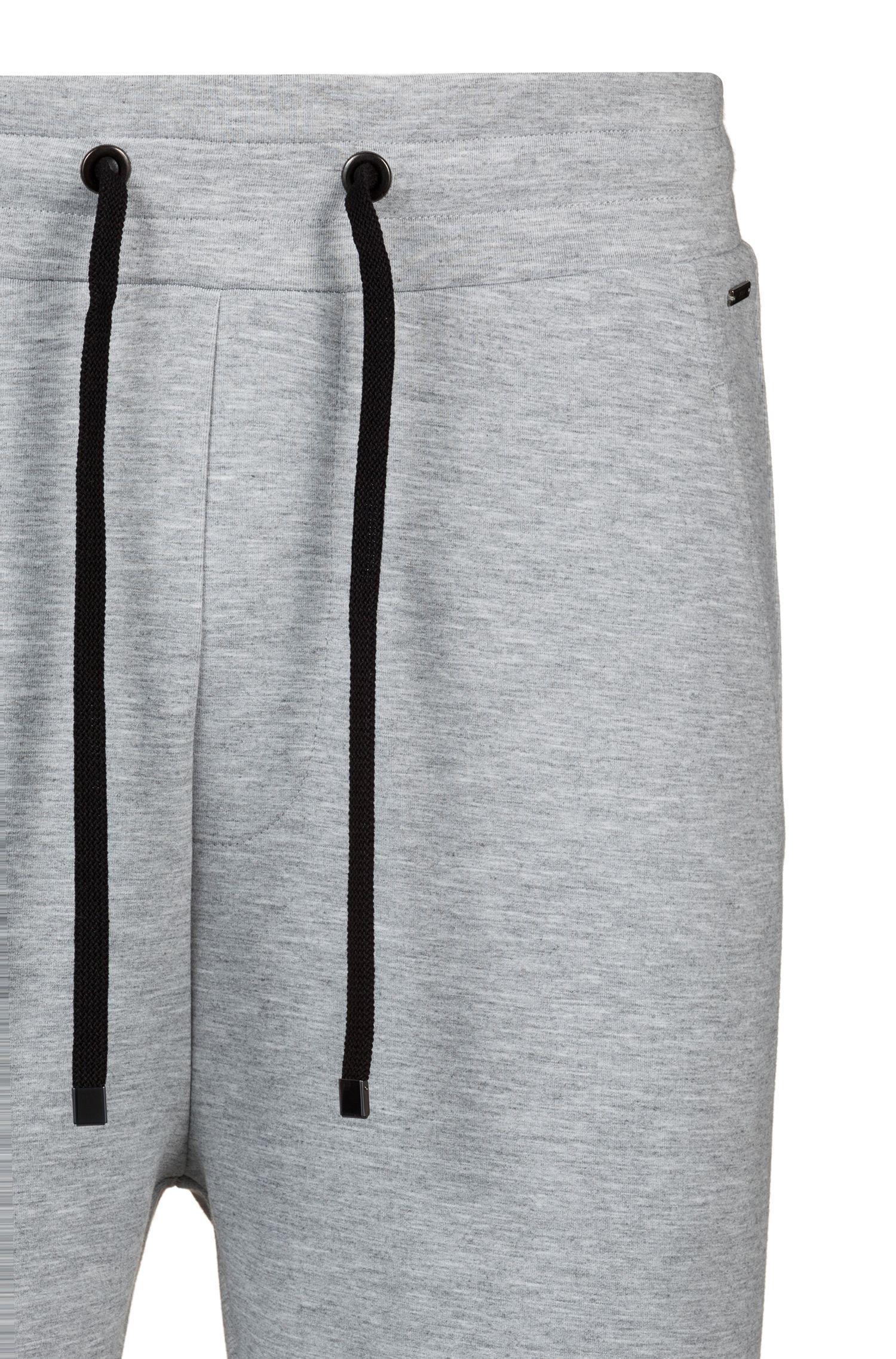 Pantaloni regular fit in jersey elasticizzato con fondo gamba con zip, Grigio scuro