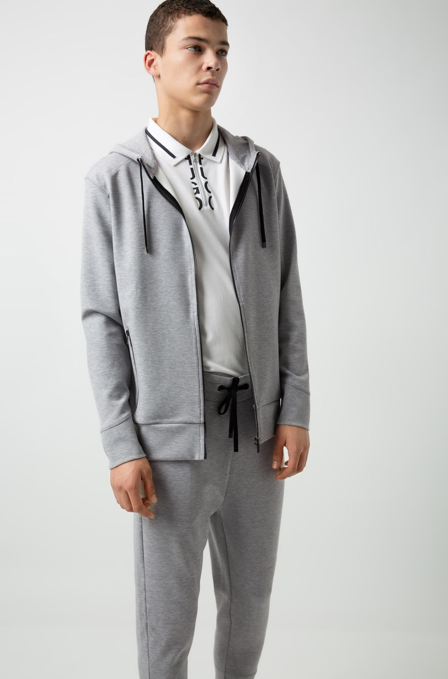 Pantalones regular fit en tejido de punto elástico con cremallera en los puños, Gris oscuro