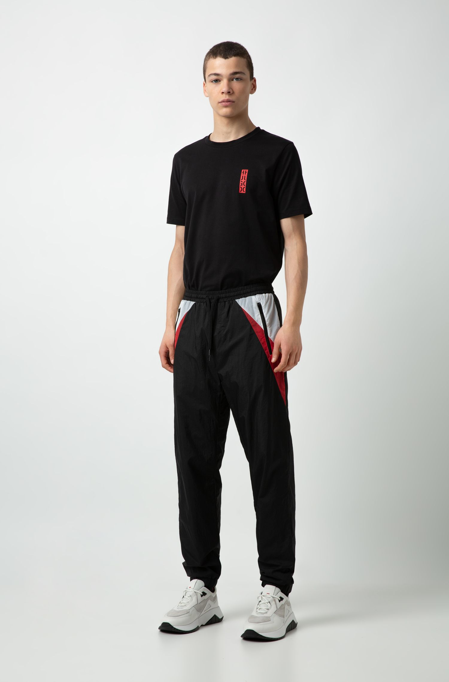 Crew-neck T-shirt in cotton with cropped HUGO logo, Black