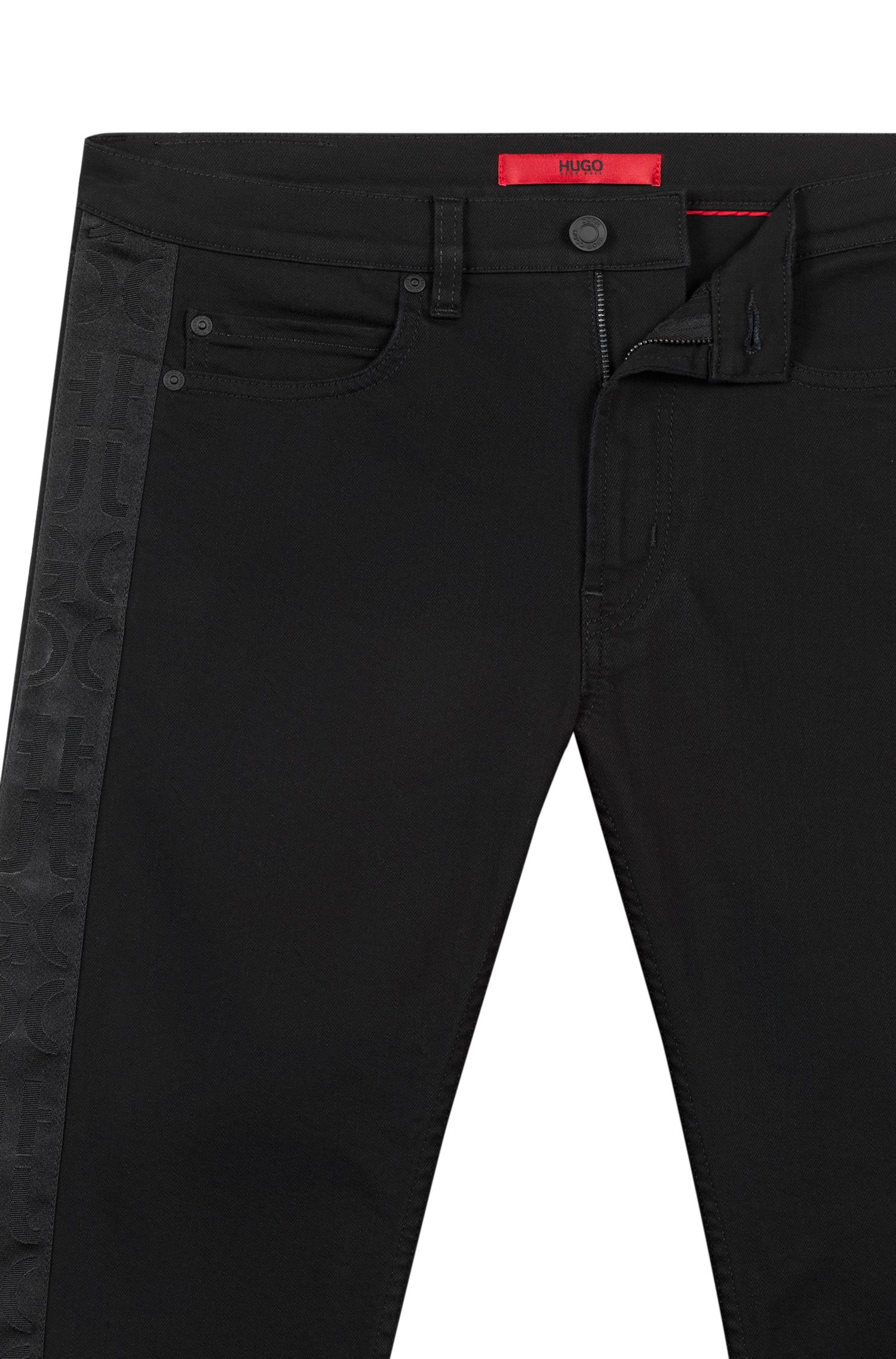 Skinny-fit black jeans with cut-logo tape detail, Black