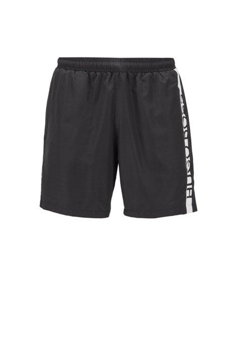 Bañador tipo shorts en tejido de secado rápido con logo truncado, Negro