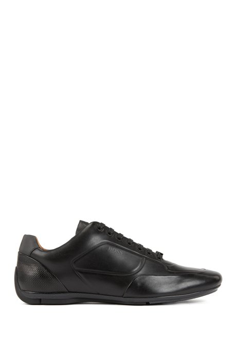 Motorsport-inspired trainers in nappa leather with monogram embossing, Black