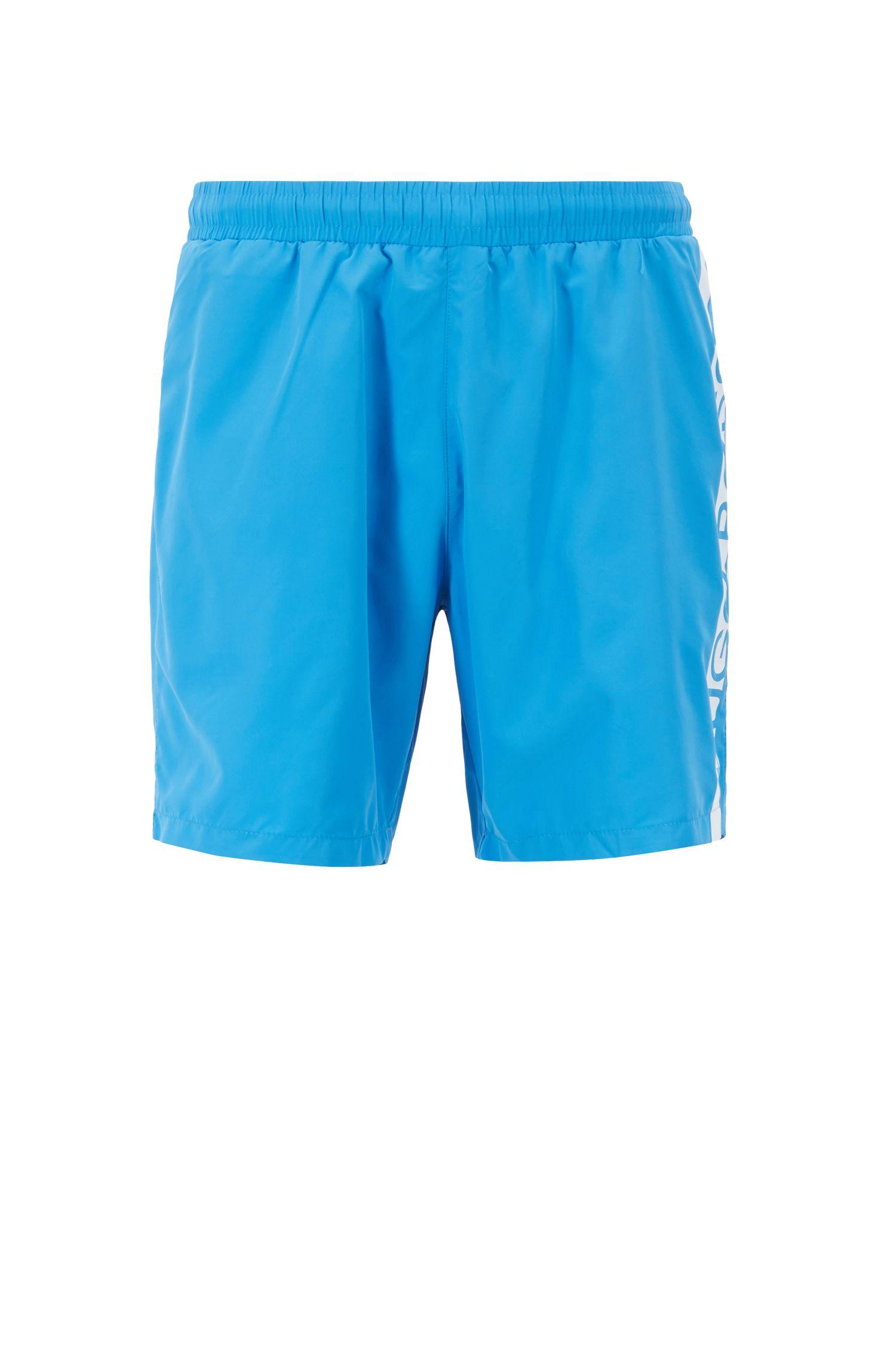 Bañador tipo shorts de largo medio con logo estampado termosellado, Azul