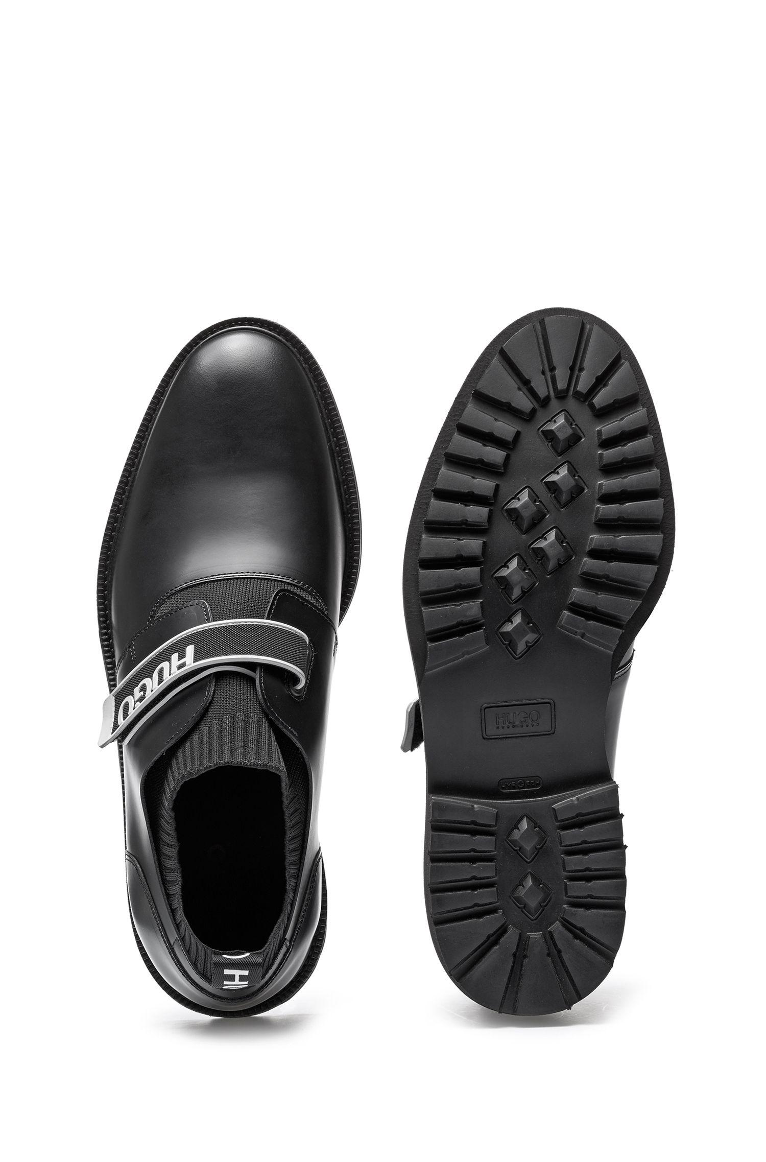 Chaussures à enfiler en cuir avec bande auto-adhésive logotée, Noir