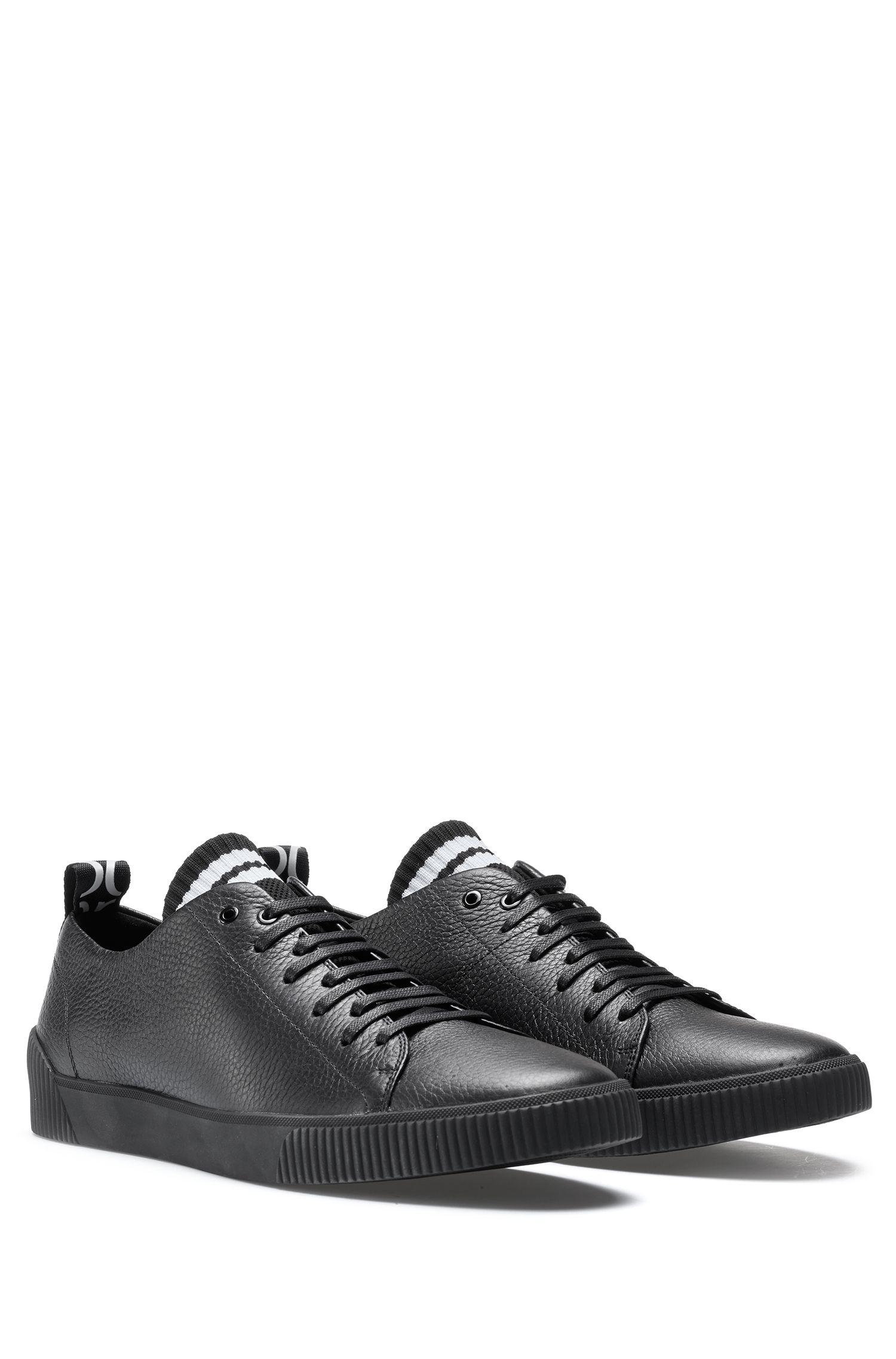 Sneakers aus genarbtem Leder mit origineller Schnürung, Schwarz