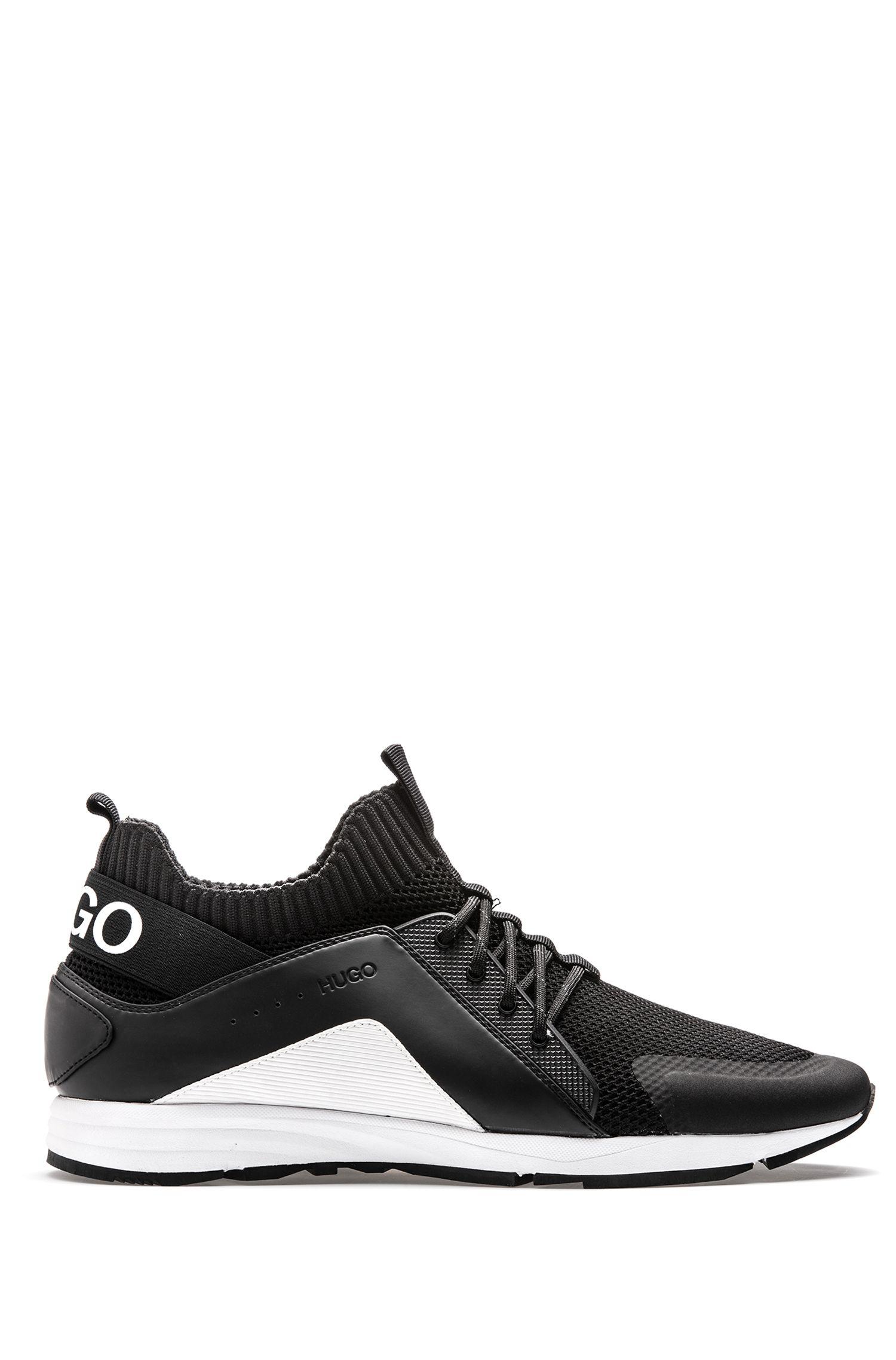 Op hardloopschoenen geïnspireerde sneakers met Vibram-zool en gebreide sok, Zwart