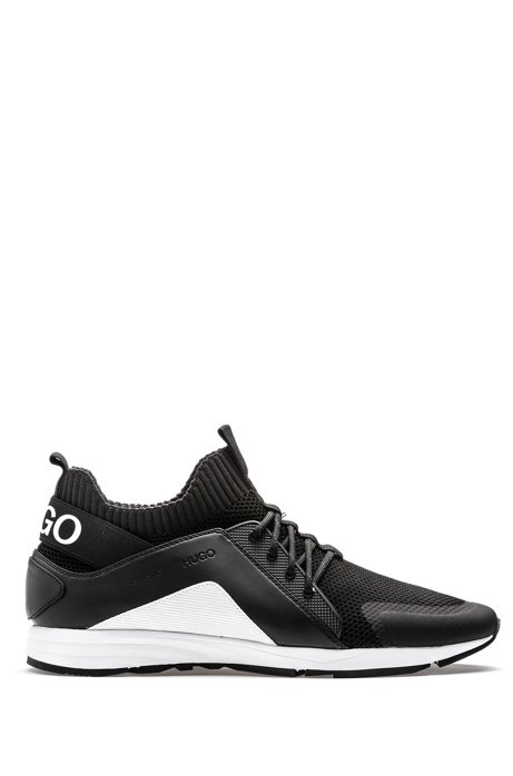 Sneakers im Laufschuh-Stil mit Vibram-Sohlen und Stricksocken, Schwarz
