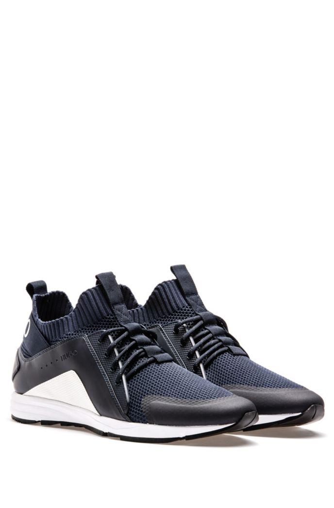 Sneakers im Laufschuh-Stil mit Vibram-Sohlen und Stricksocken
