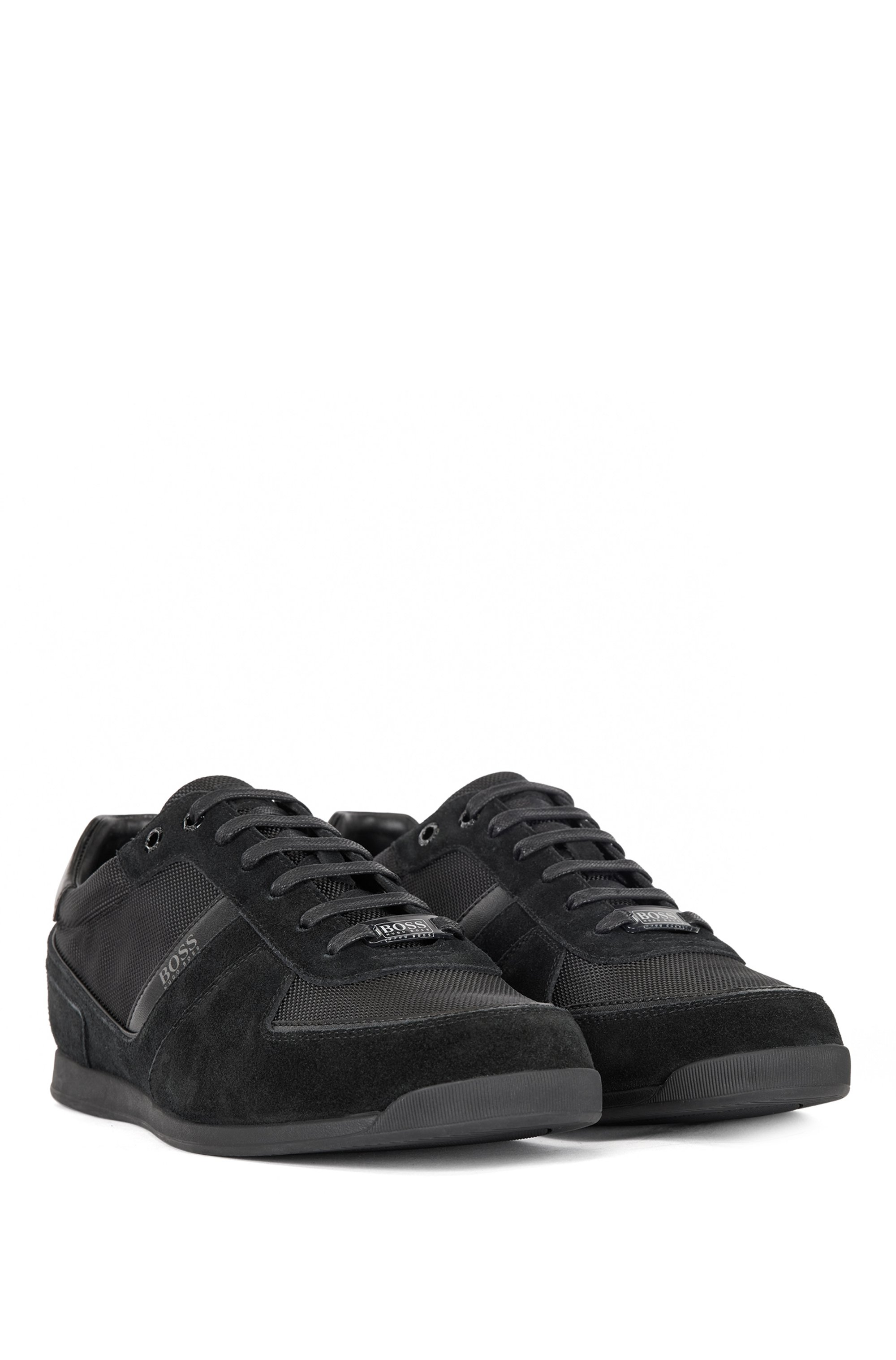 Low-top trainers in leather, suede and technical fabric