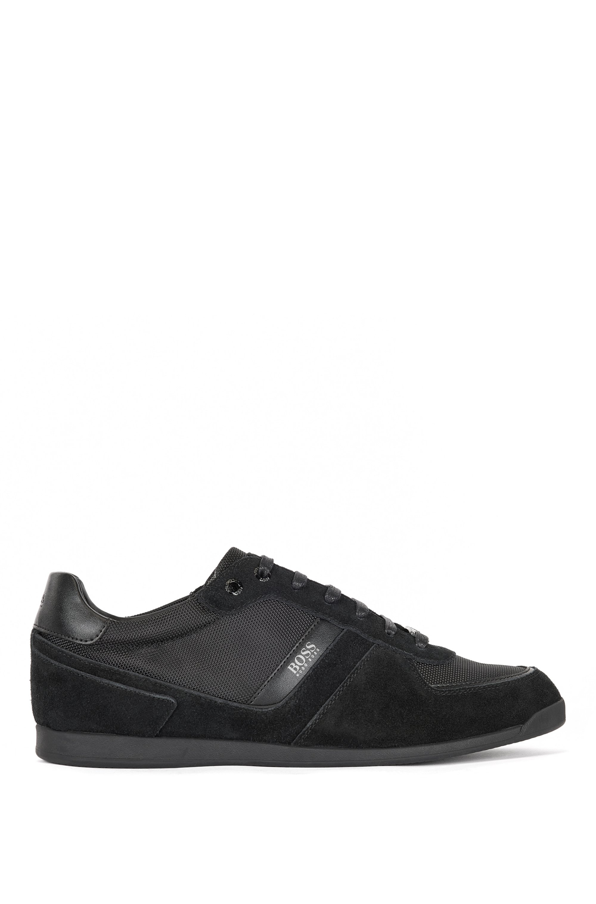 Low-top trainers in leather, suede and technical fabric, Black