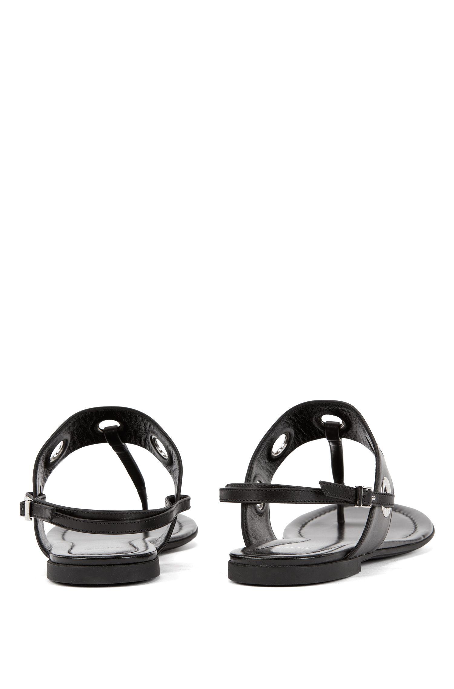 Ledersandalen mit T-Steg und abnehmbaren Fesselriemen, Schwarz