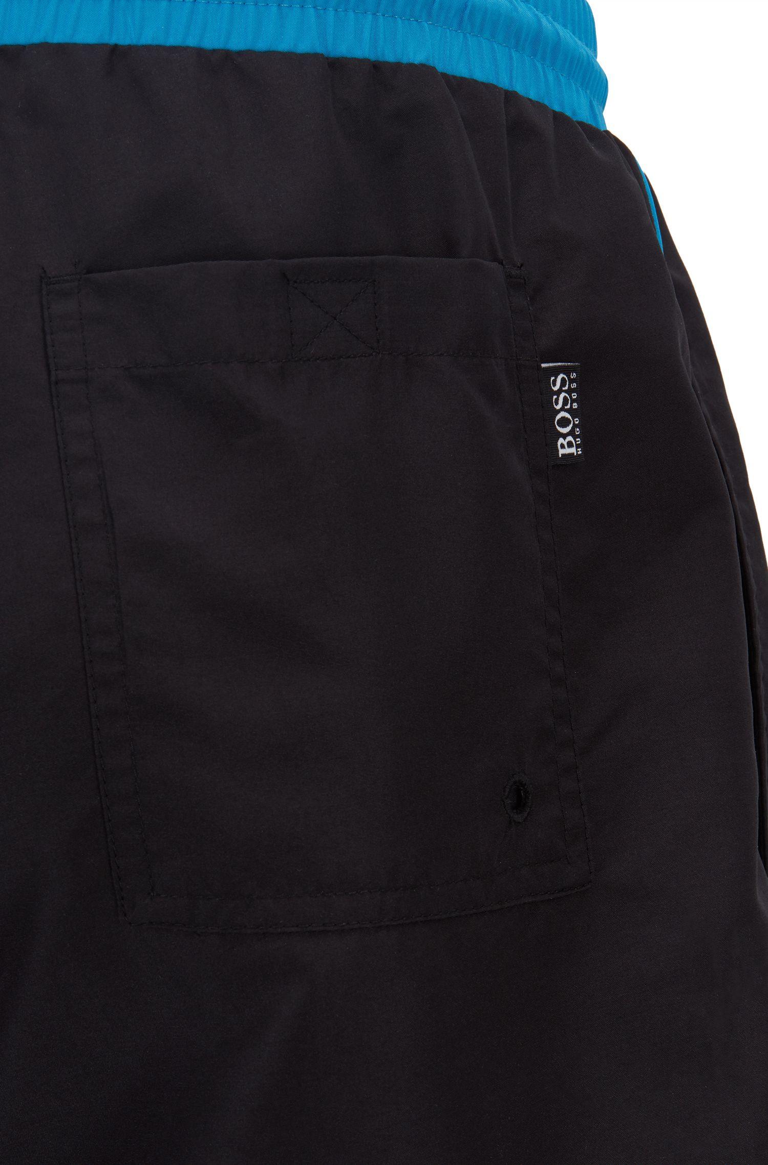 Bañador tipo shorts de largo medio en tejido de secado rápido, Negro