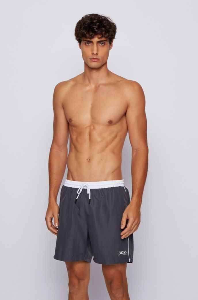 Medium-length swim shorts in quick-drying fabric