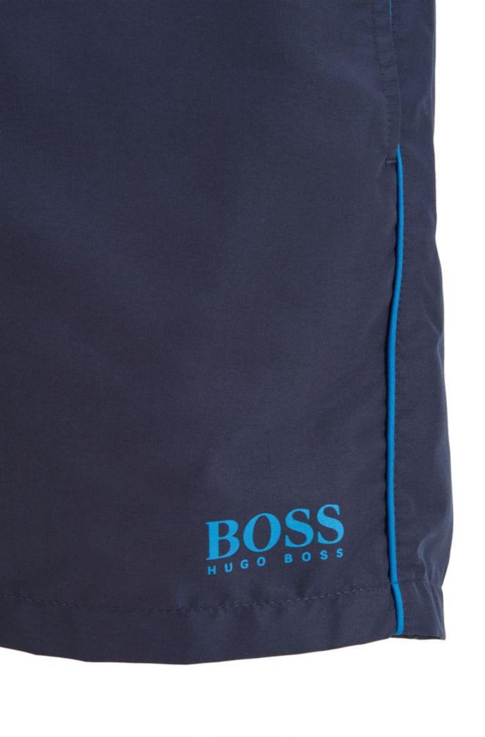 Medium-length swim shorts in quick-drying fabric