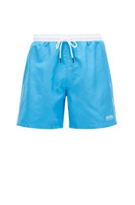 Bañador tipo shorts de largo medio en tejido de secado rápido, Azul