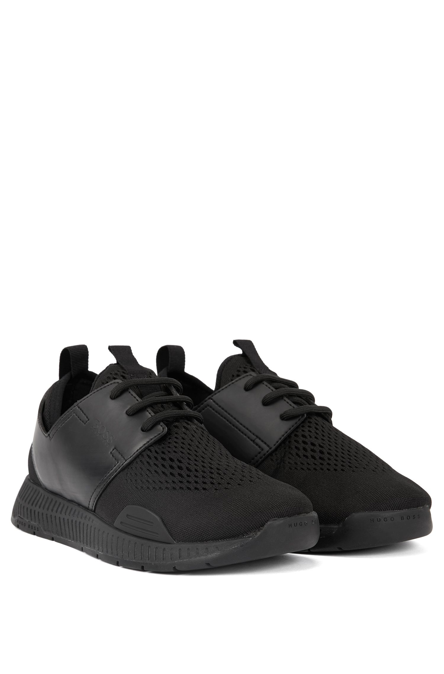 Unisex low-top trainers with perforated mesh uppers, Black