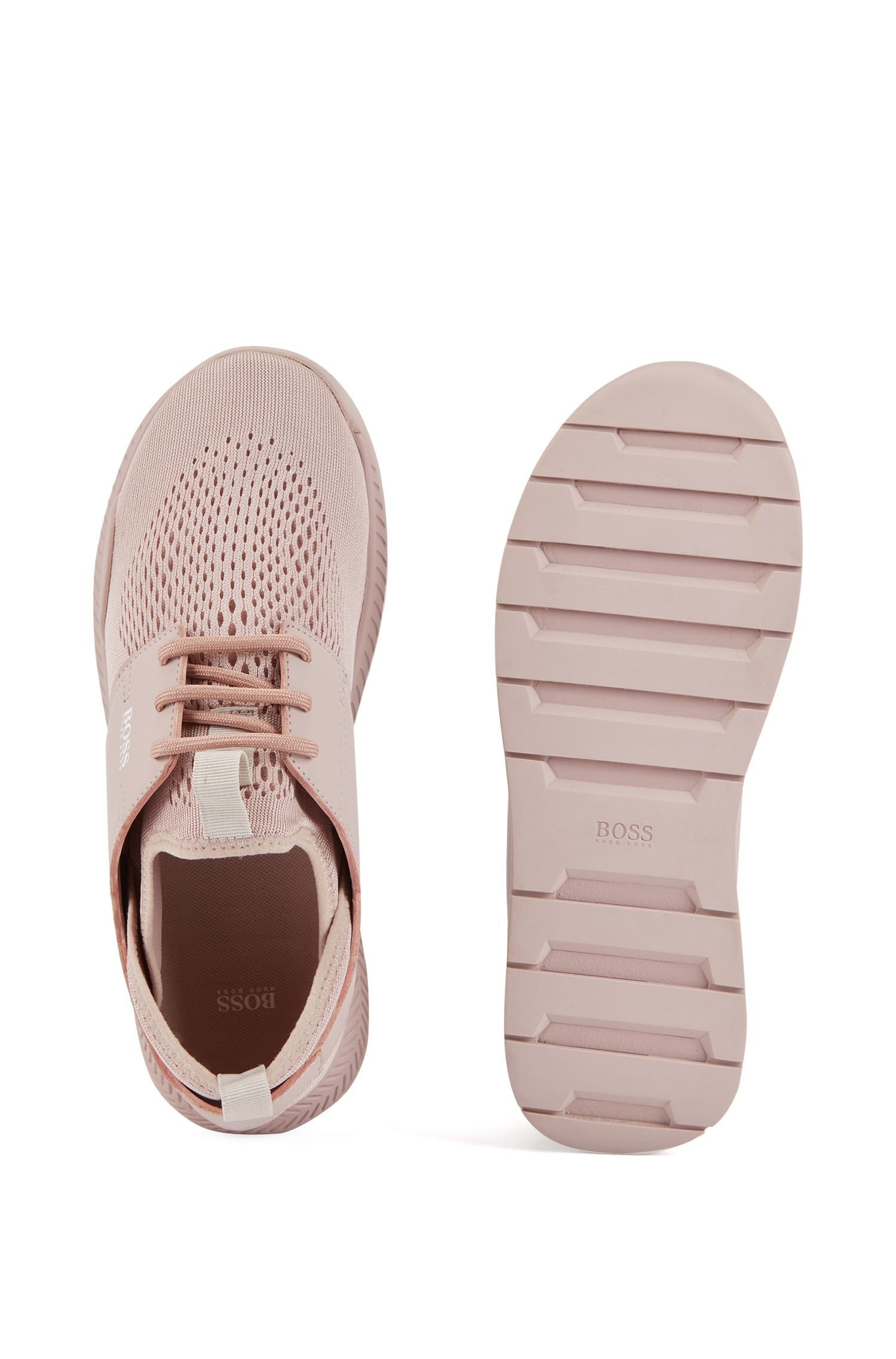 Unisex low-top trainers with perforated mesh uppers, light pink
