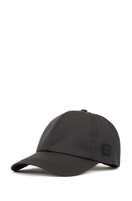 Garment-washed cap in Tyvek® with silicone logo badge, Black