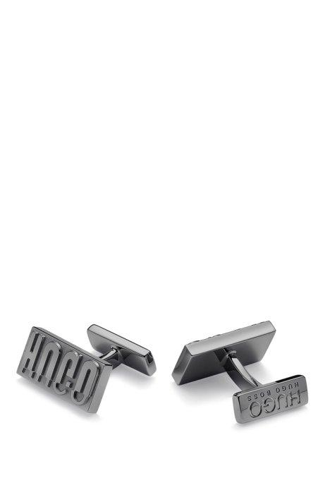 Reinterpreted reverse-logo cufflinks in polished brass, Dark Grey