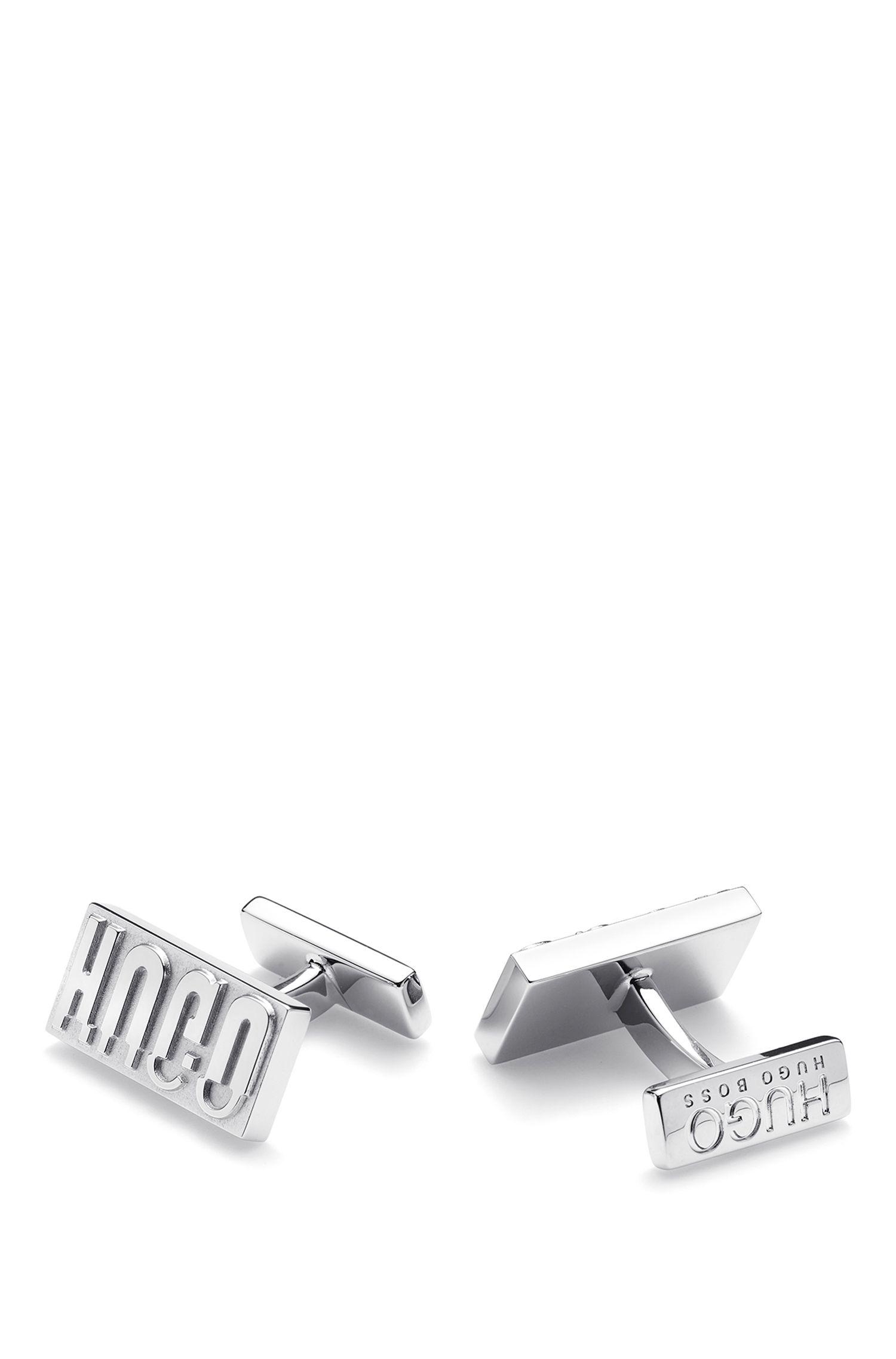Nieuw geïnterpreteerde manchetknopen van gepolijst messing met gespiegeld logo, Zilver