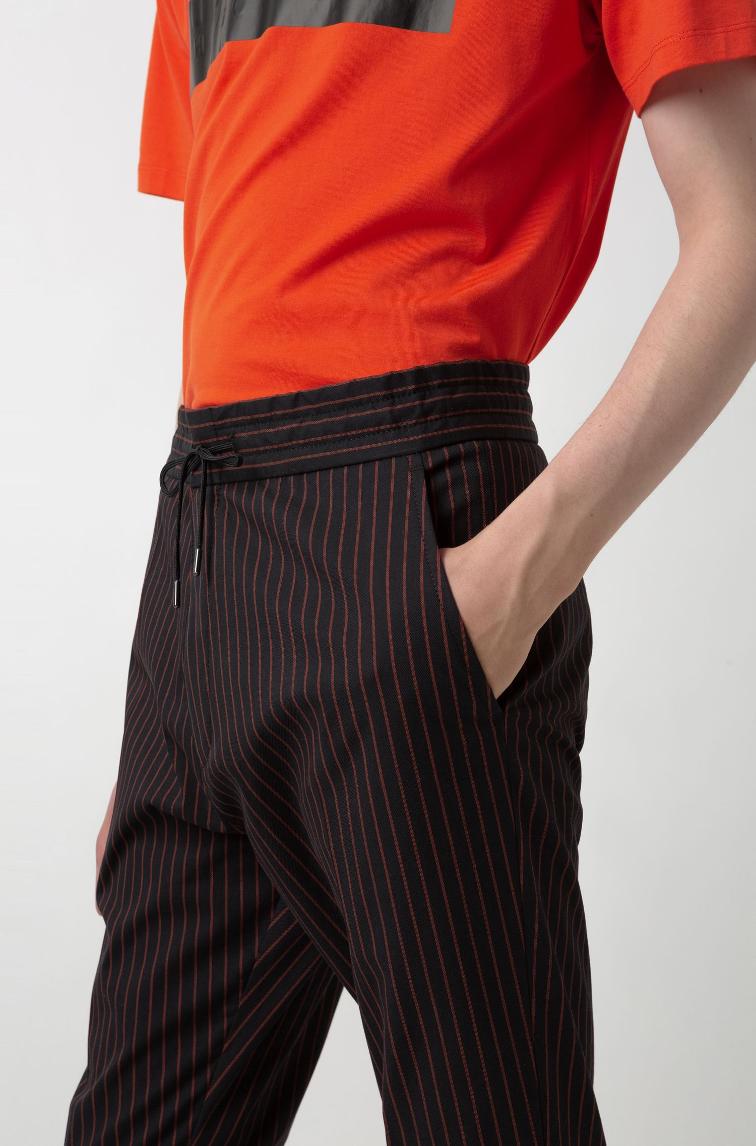 Tapered-fit pinstripe trousers with drawstring waistband, Patterned