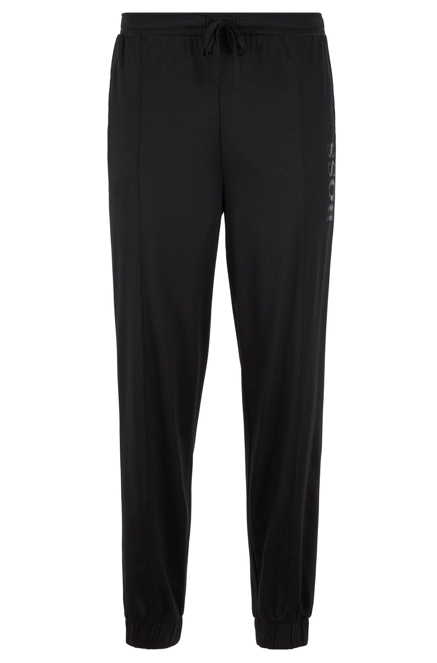 Pantalones de pijama con los bajos vueltos y logo con estampado plateado, Negro