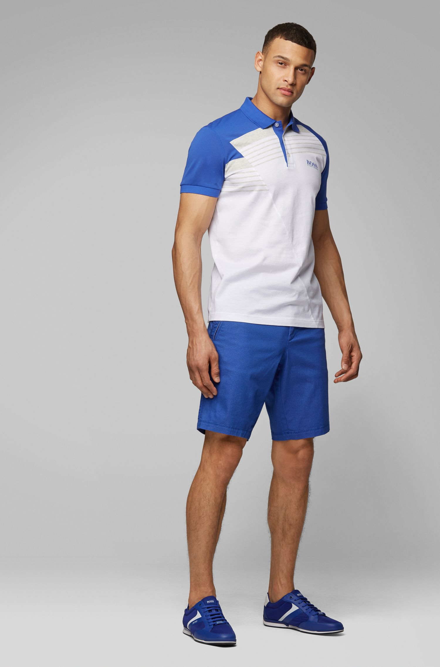 Moisture-wicking polo shirt with engineered stripes, White