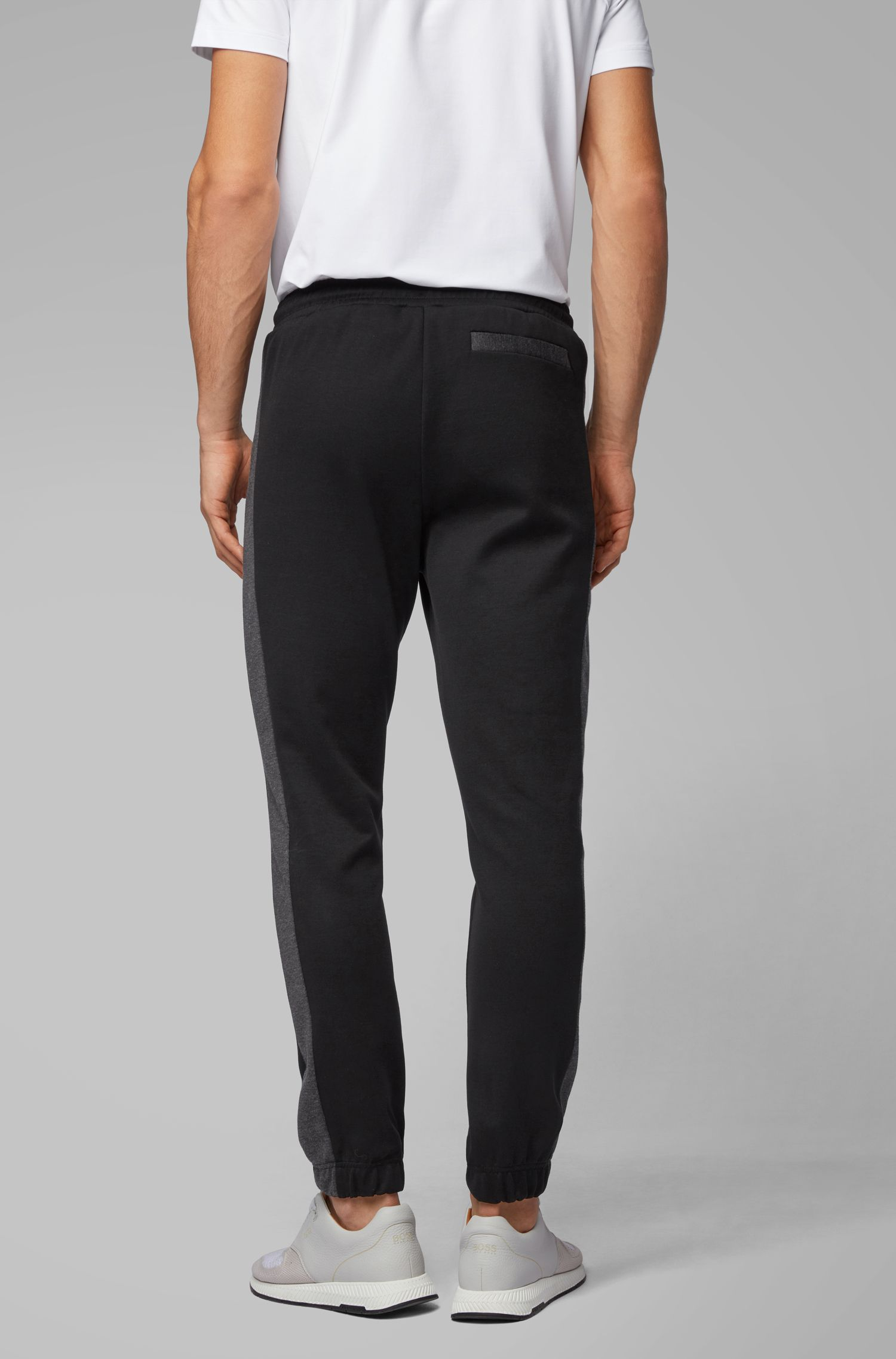 Pantalon de jogging Slim Fit à logo incurvé, Noir