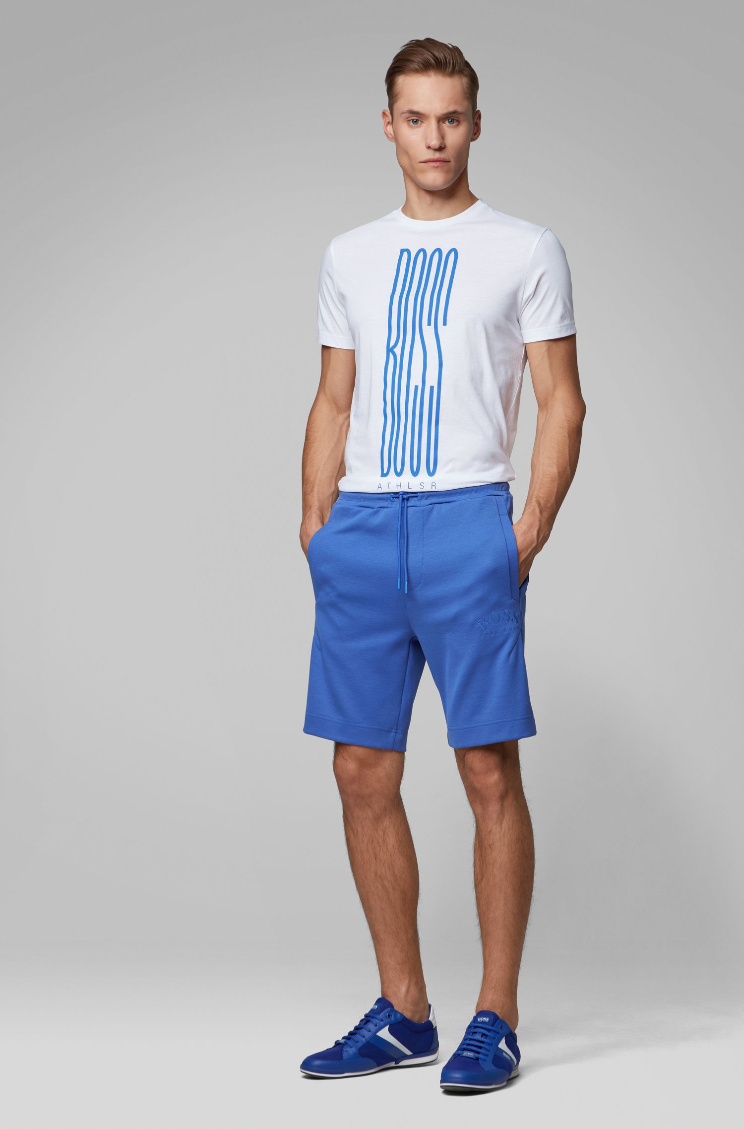 Slim-fit jogging shorts in contrast fabrics with curved logo, Blue