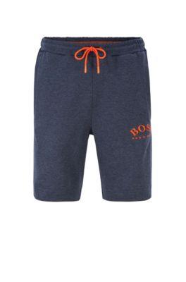 Shorts de chándal slim fit en tejidos contrastados con logo curvado, Azul oscuro