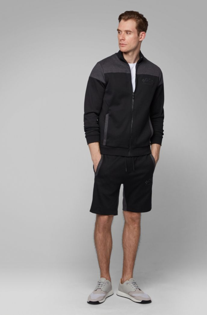 Zip-through sweatshirt in contrast fabrics with curved logo