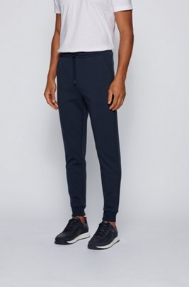 Slim-fit jogging trousers with layered logo, Dark Blue
