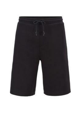 Pantaloncini relaxed fit con tasca con logo goffrato, Nero