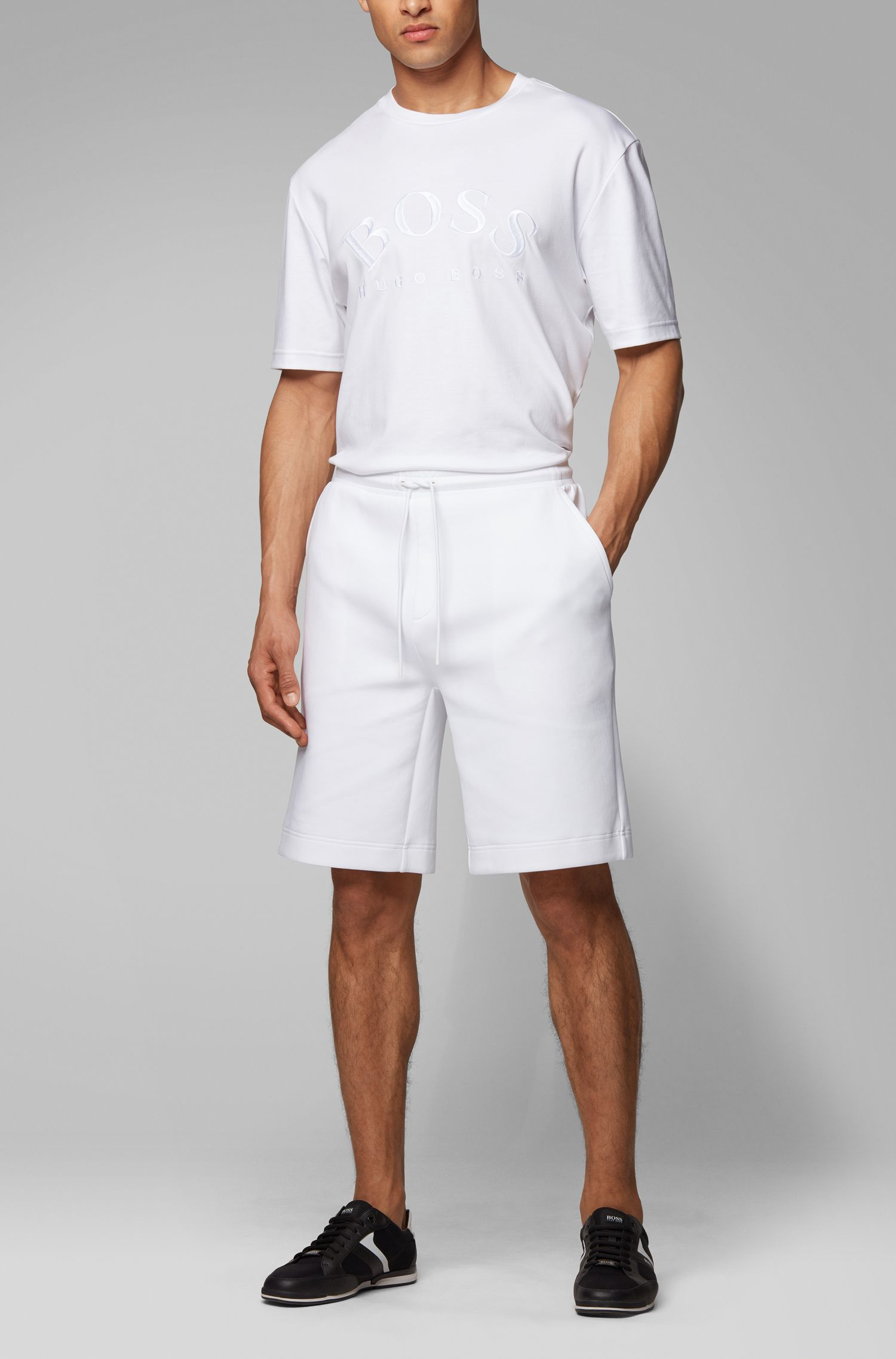 Relaxed-fit shorts with logo-embossed pocket, White