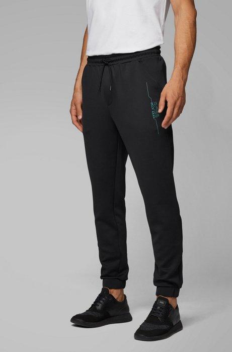 Pantalon de jogging Slim Fit à logo artistique, Noir