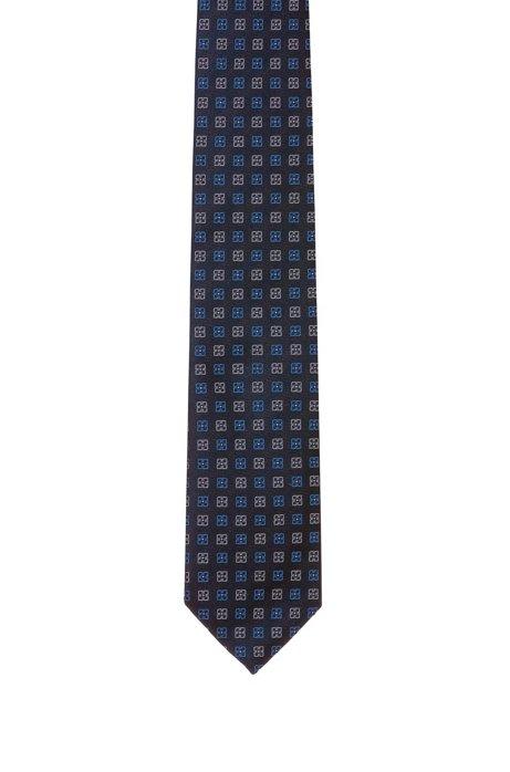 Cravatta in seta jacquard con motivo geometrico a fiori, A disegni
