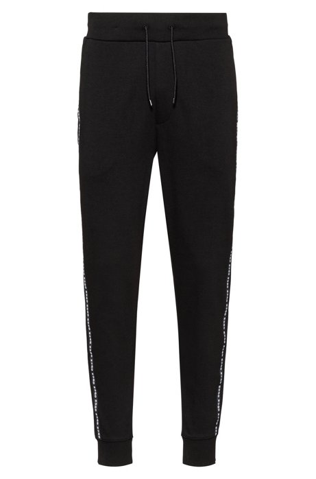Cuffed-hem interlock-cotton trousers with logo-tape side seams, Black