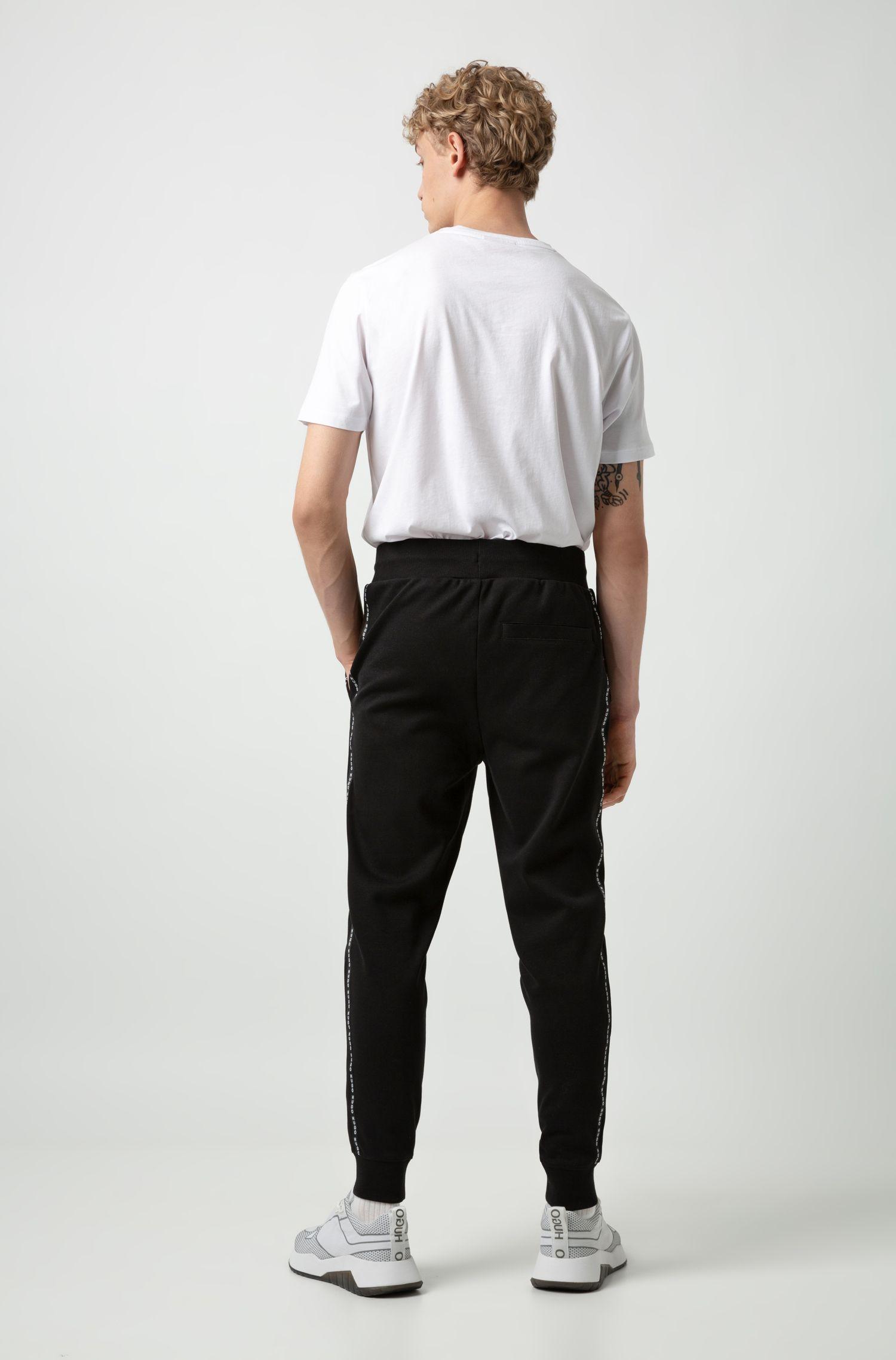 Jogginghose aus Interlock-Baumwolle mit seitlichem Logo-Tape, Schwarz