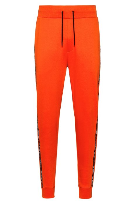 Cuffed-hem interlock-cotton trousers with logo-tape side seams, Orange