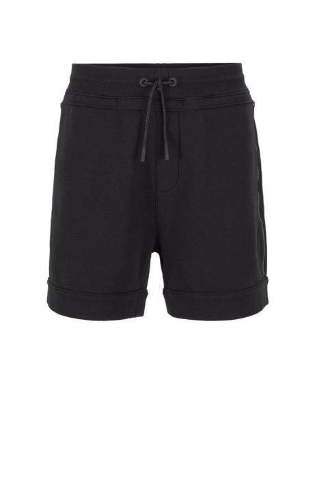 Shorts relaxed fit en felpa de rizo con bolsillos con cremallera, Negro