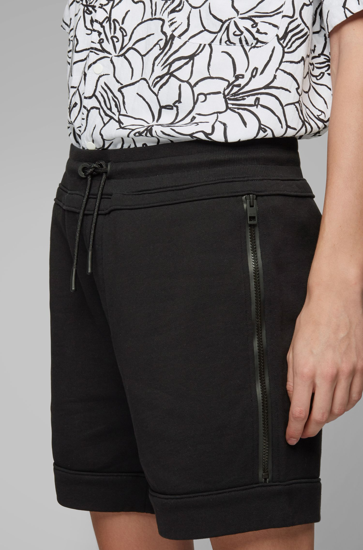 Relaxed-Fit Shorts aus French Terry mit Reißverschlusstaschen, Schwarz