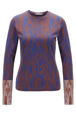 Slim-fit jersey top met all-over-dessin, Bedrukt