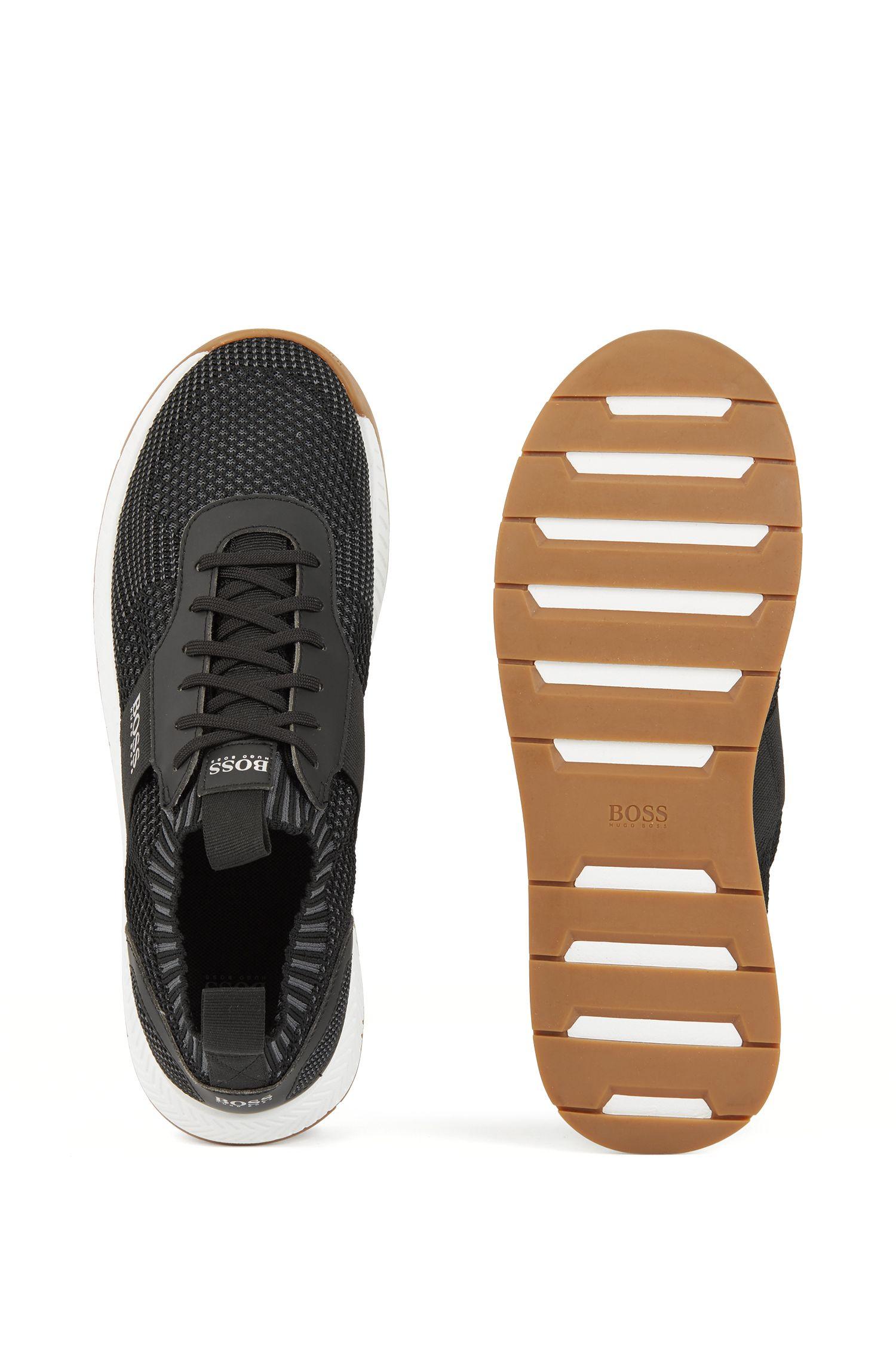 Sneakers in stile runner con stringhe e tomaia lavorata a maglia, Nero