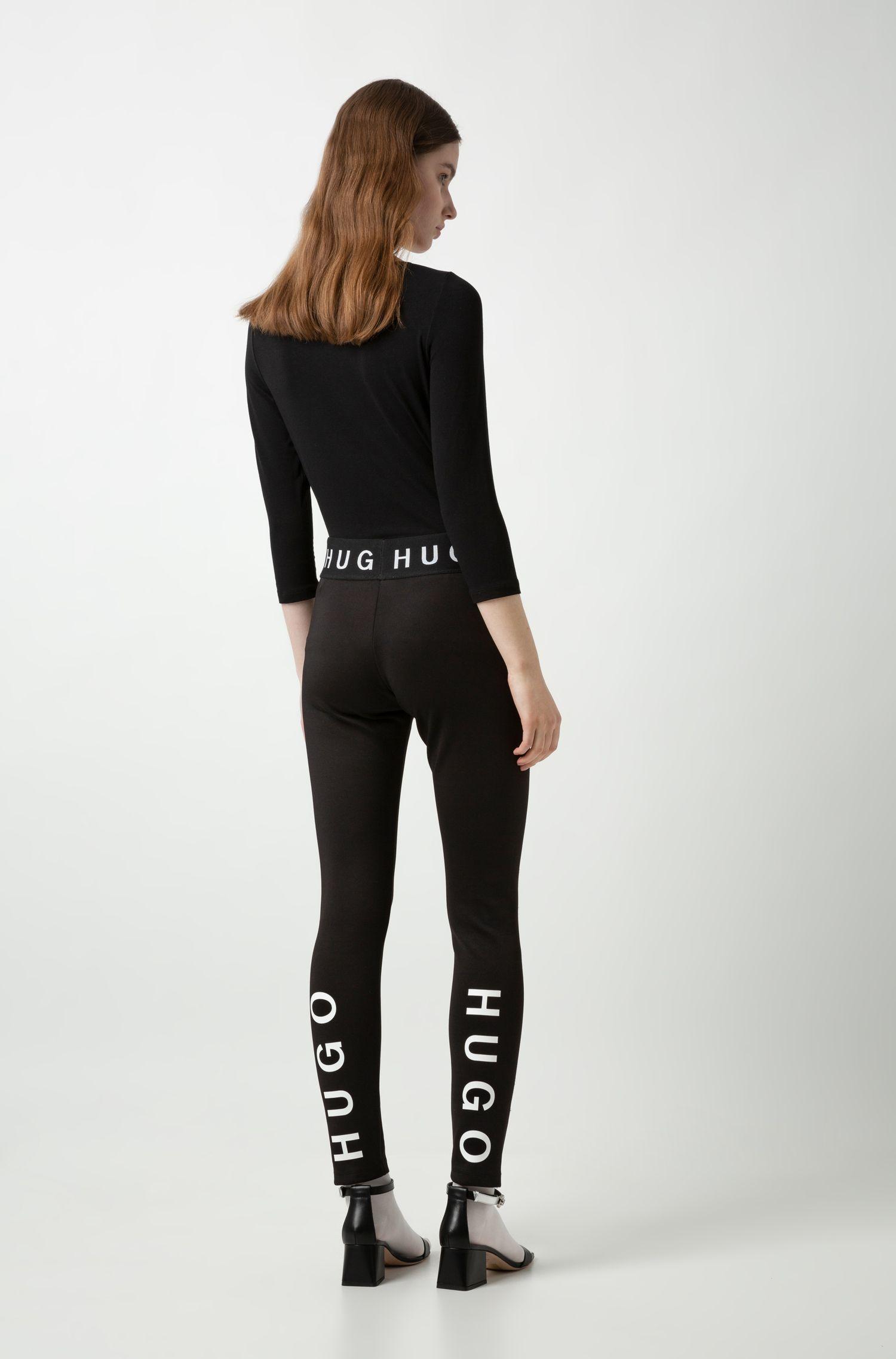 Leggings slim fit en tejido elástico con detalles del logo, Negro
