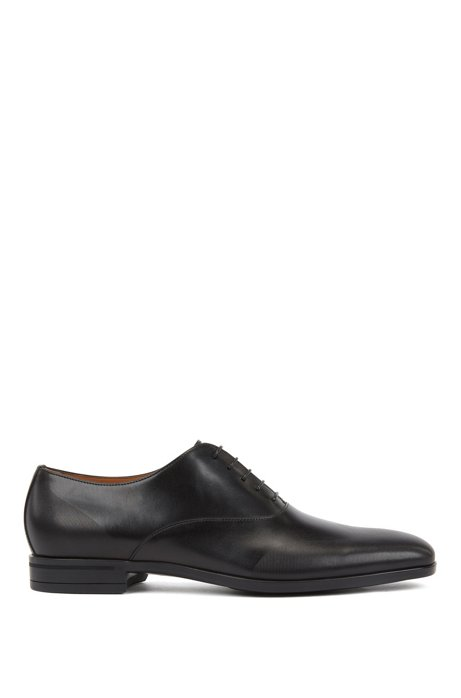 Oxford shoes in burnished leather with laser-cut panels, Black