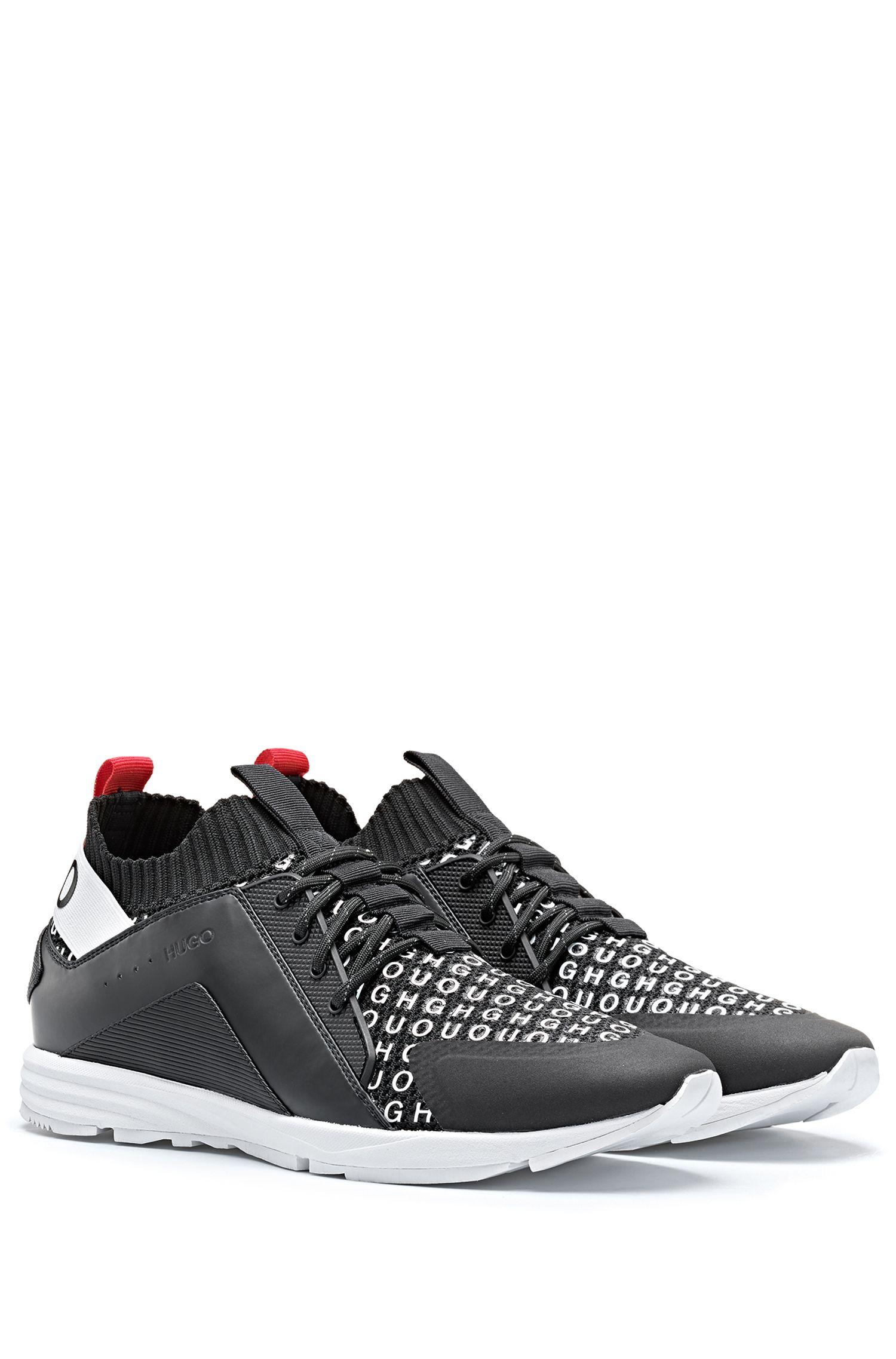 Sneakers mit gestricktem Sockenschaft und Logo auf dem Schuhblatt, Schwarz