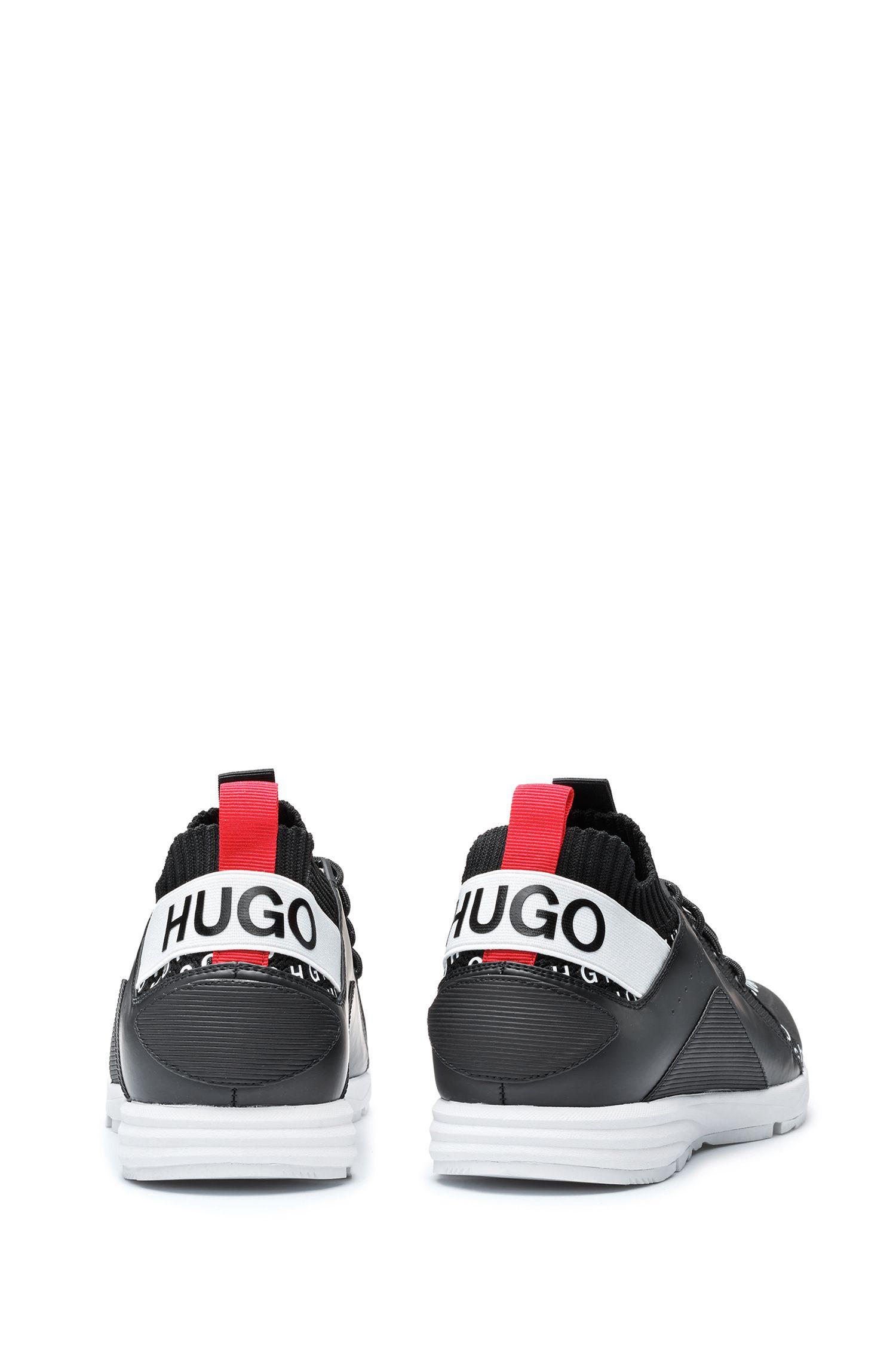 Sneakers a calza con tomaia con logo ripetuto, Nero
